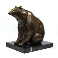 Large and heavy statue of bronze bear on marble foot