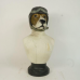 Bust of a dog with flying helmet and goggles
