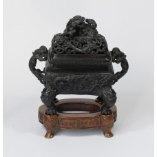 Chinese bronze incense burner on wooden support